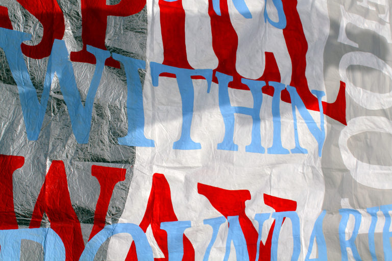 A banner with blue, red and white overlapping words