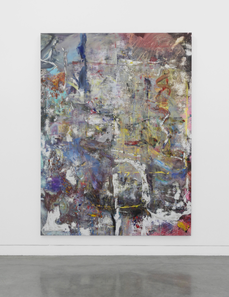 An abstract painting hangs on a white wall over a grey floor