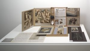 <p>This work consists of dozens of reproductions, some sculptural, but most on paper, which can be stacked, bundled up, and stored in a cardboard box that fits inside a brown leather valise. When the valise is opened, several panels unfold from within to create, in essence, the walls of a small, portable museum. Miniatures of the artist's most famous sculptures are displayed in this tiny gallery, including 'Fountain', and '50cc air de Paris'. On the unfolded walls are prints of some of Duchamp's Cubist paintings, and photographs of elaborate sculptures. Additional prints and sheets of handwritten text can be removed from the valise and displayed lying flat, or standing upright on folding frames that resemble greeting cards. The loose pieces include a photo of Duchamp's sculpture 'Bottle Rack', and a [doctored] print of Leonardo da Vinci's 'Mona Lisa'.</p>
