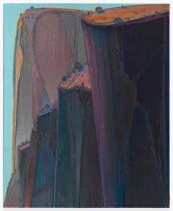 This five-and-a-half foot tall, four-and-a-half foot wide oil painting features a row of massive, towering cliffs rendered in indigo, purple, and orange. The dark and precipitous cliffs occupy the entire painting save for thin slivers of pale blue sky on our left and at the upper edges of the canvas. In the foreground on our right is a massive, sheer, indigo and purple cliff, topped with a tilted orange field dotted with tiny trees. Its shape resembles that of a smooth-sided pint glass, filled to the brim: straight, slightly tapered sides, with a flat top and a round rim. Just beyond it, a series of lower tiered cliffs, one behind the other, descends to our left. The cliff faces are mostly smooth, but feature a network of raised veins up and down their faces. They are topped with heavy clots of blue, mauve, and orange paint. In the distance, filling the upper left corner of the canvas is another massive escarpment, rendered in faded colors from the same palette. The orange field on top curves over the edge and falls in two thin lines down the front of the smooth rock face like water over a waterfall.